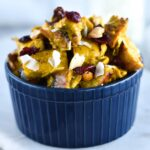 Bowl of chicken salad with curry, cranberries, coconut and cashews