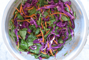 Cabbage, carrots and kale shredded in a bowl