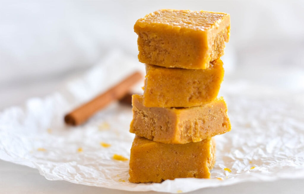Stack of four pieces of pumpkin fudge