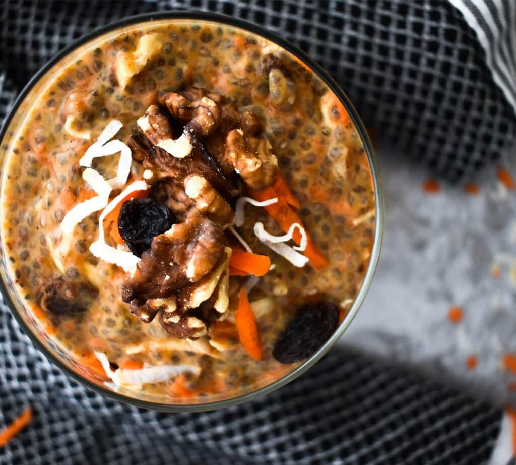 Chia pudding with carrot, pumpkin, raisins, coconut, walnuts and spices.