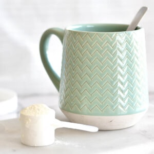 Coffee cup with scoop of collagen