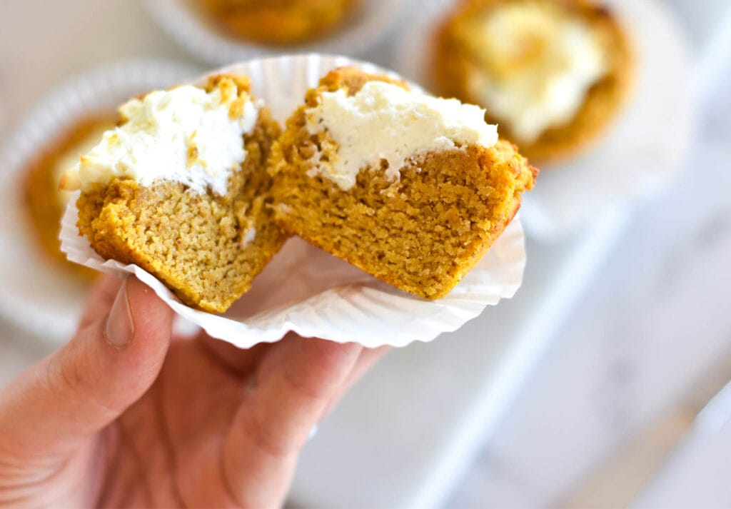 Moist cream cheese filled pumpkin muffin cut in half