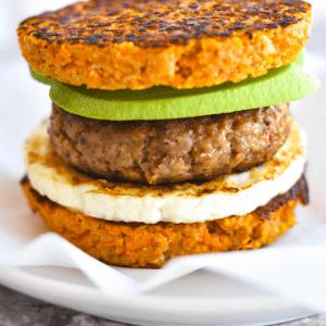breakfast sandwich made of sweet potato, egg, sausage and avocado