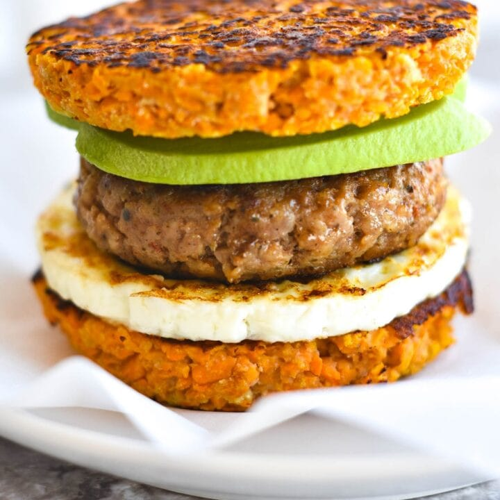 breakfast sandwich made of sweet potato, egg, sausage and avocado
