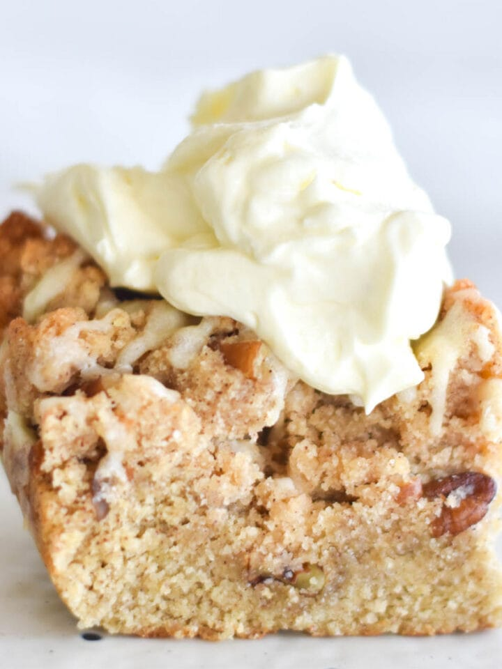 Coffee cake with large dollop of keto whipped cream.