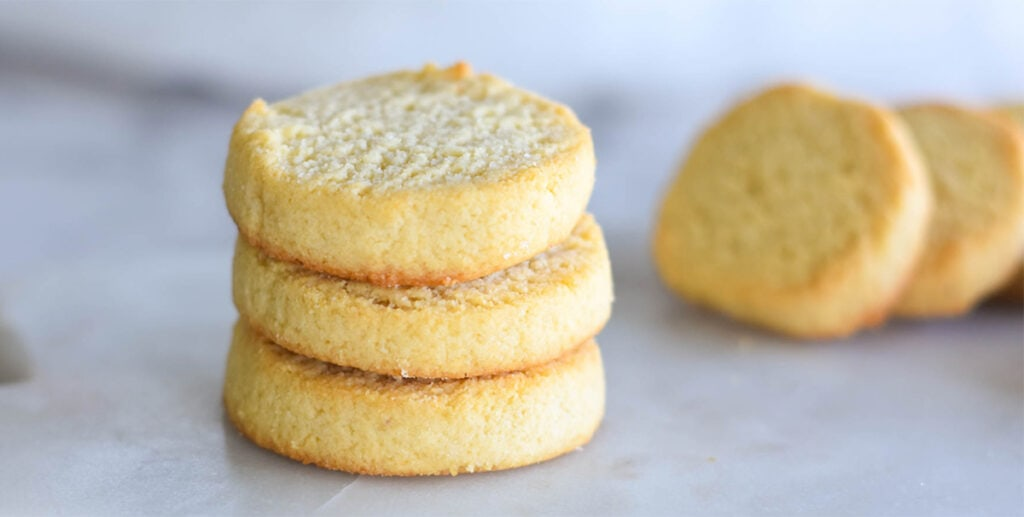 Stack of three golden buttery keto shortbread cookies.
