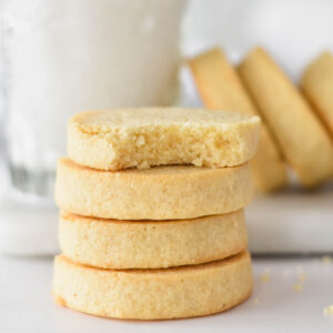 Stack of four buttery keto shortbread cookies.