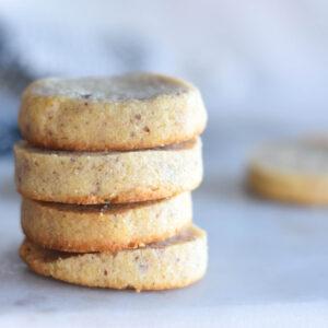 Stack of golden brown four keto pecan dandies cookies.