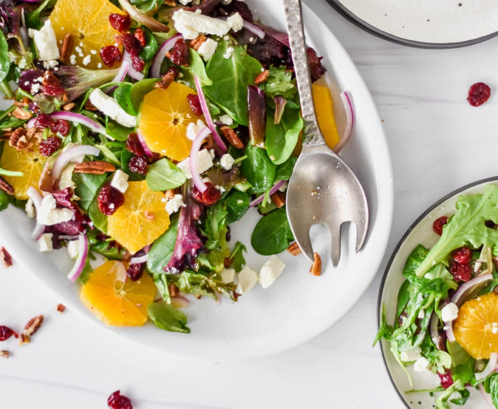 Salad with oranges, cherries, feta, pecans and red onions.