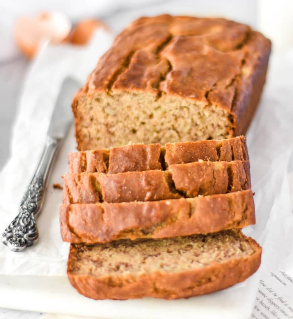 Slicced loaf of banana bread made with chickpea flour.