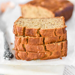 Stack of four slices of chickpea flour banana bread.