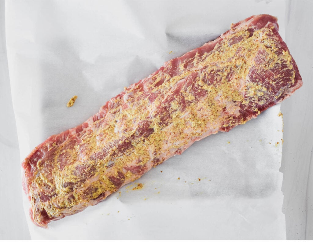 Ribs rubbed with coarse ground mustard.