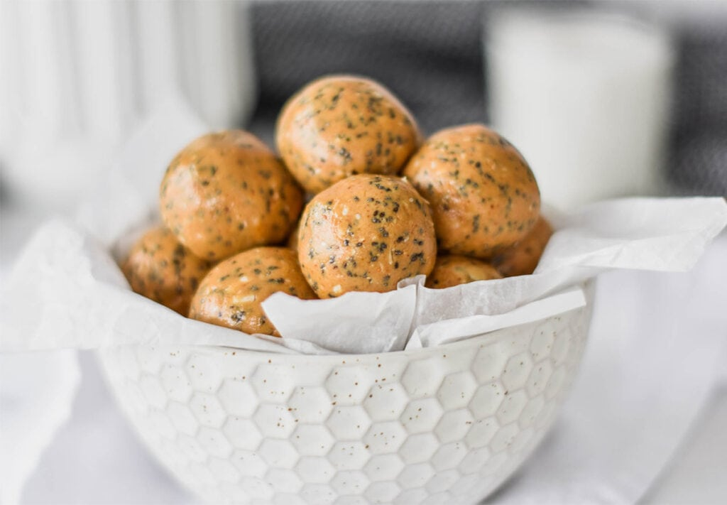 White bowl filled with peanut butter and chia protein balls.