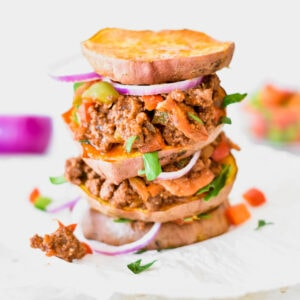 Triple decker Whole30 sloppy joe with red onion and sweet potato rounds instead of buns.