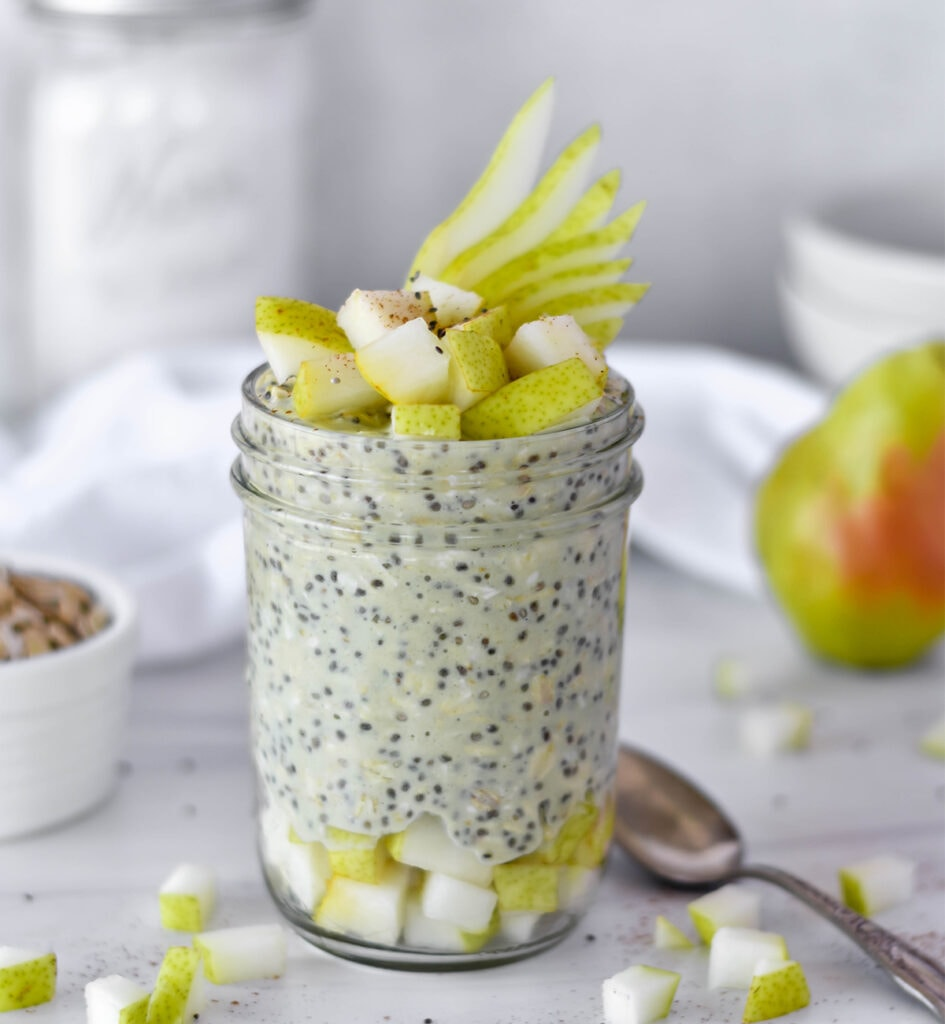 Mason jar filled with overnight oats and pears.