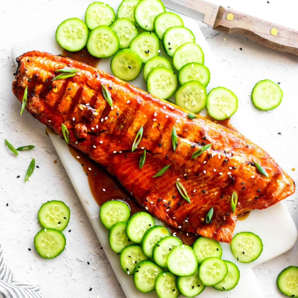 Salmon filet covered with paleo teriyaki sauce, sesame seeds and green onions.