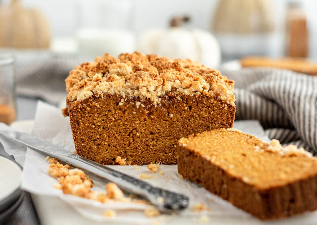 Sliced loaf of Paleo Pumpkin Bread topped with almond flour streusel.
