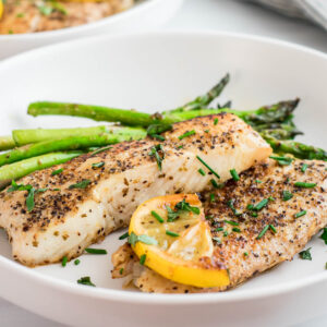 Pan-Seared Halibut coated with seasoning, butter, herbs and lemon.